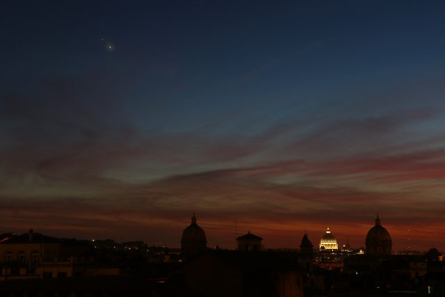 Venus and Jupiter, partly covered by a tiny cloud, are enriching the sight of the skyline in Rome: 29 June 2015