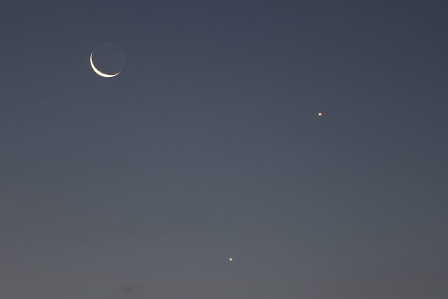 A close-up with the Moon, Venus and an airplane