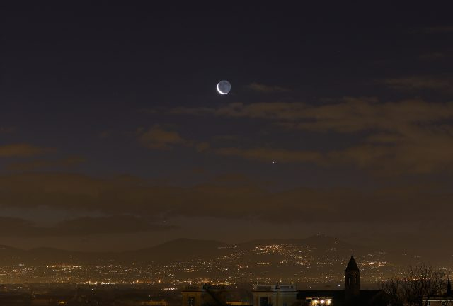 A sharp crescent Moon, Venus and Mercury are hanging above the Roman Castles, as seen from Gianicolo, in Rome. 6 Feb. 2016