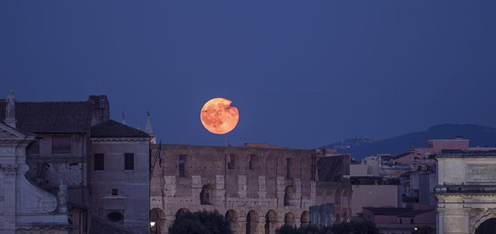 The Full Moon is rising above the Colosseum, on 20 July 2016