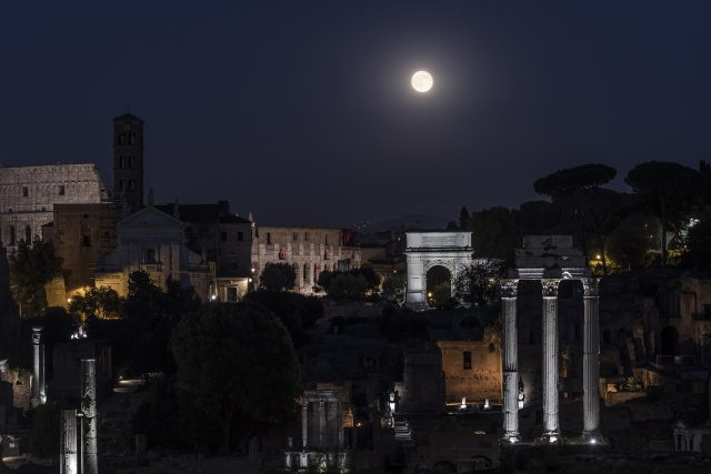 The beautiful Full Moon is shining above the Roman Forum