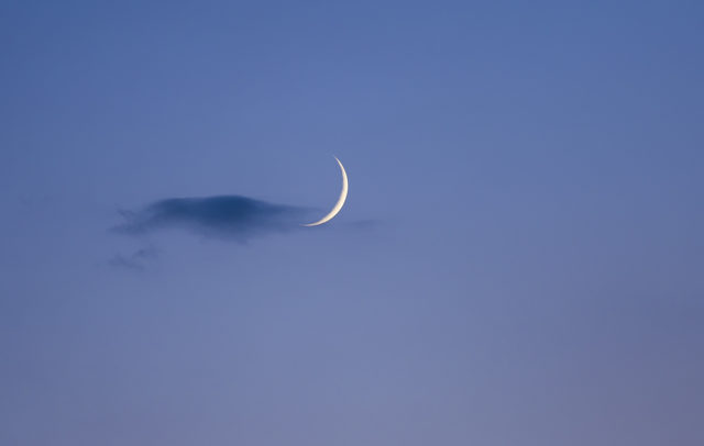 A very sharp Moon crescent was caressed by a very delicate cloud