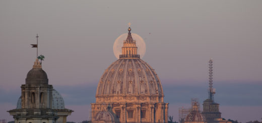 The Supermoon is perfectly behind the lantern of the St. Peter's Dome, shining in the first light of the new day