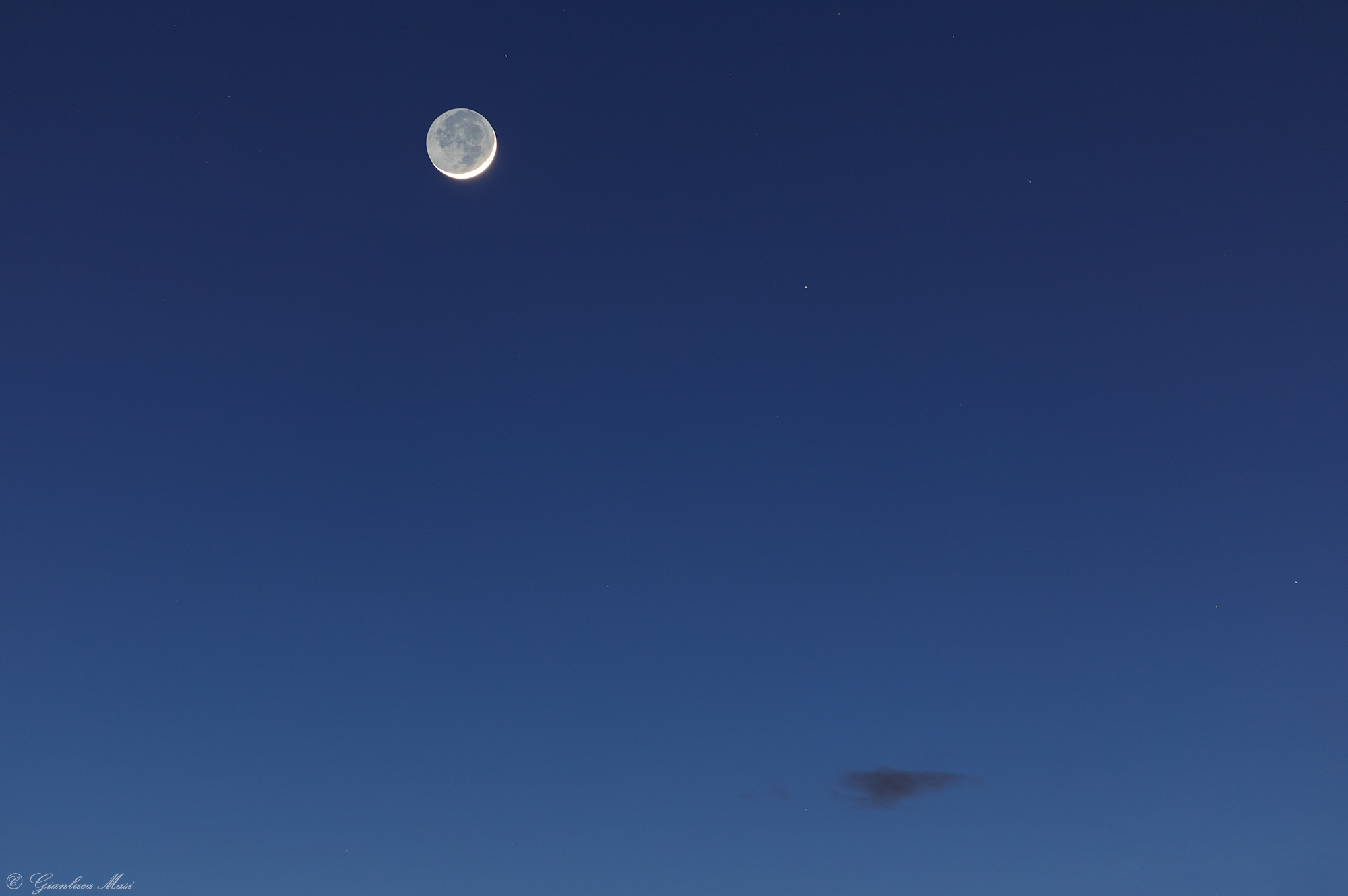 The Moon crescent shows a wonderful Earthshine, against a bluish sky