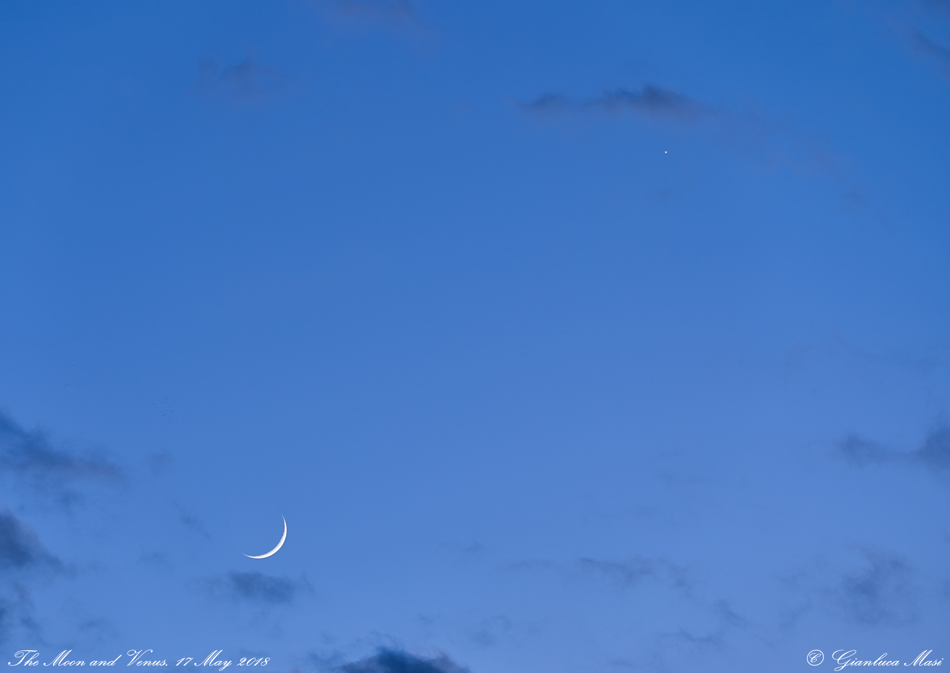 Soon after the sunset, the Moon and Venus appear among gentle clouds