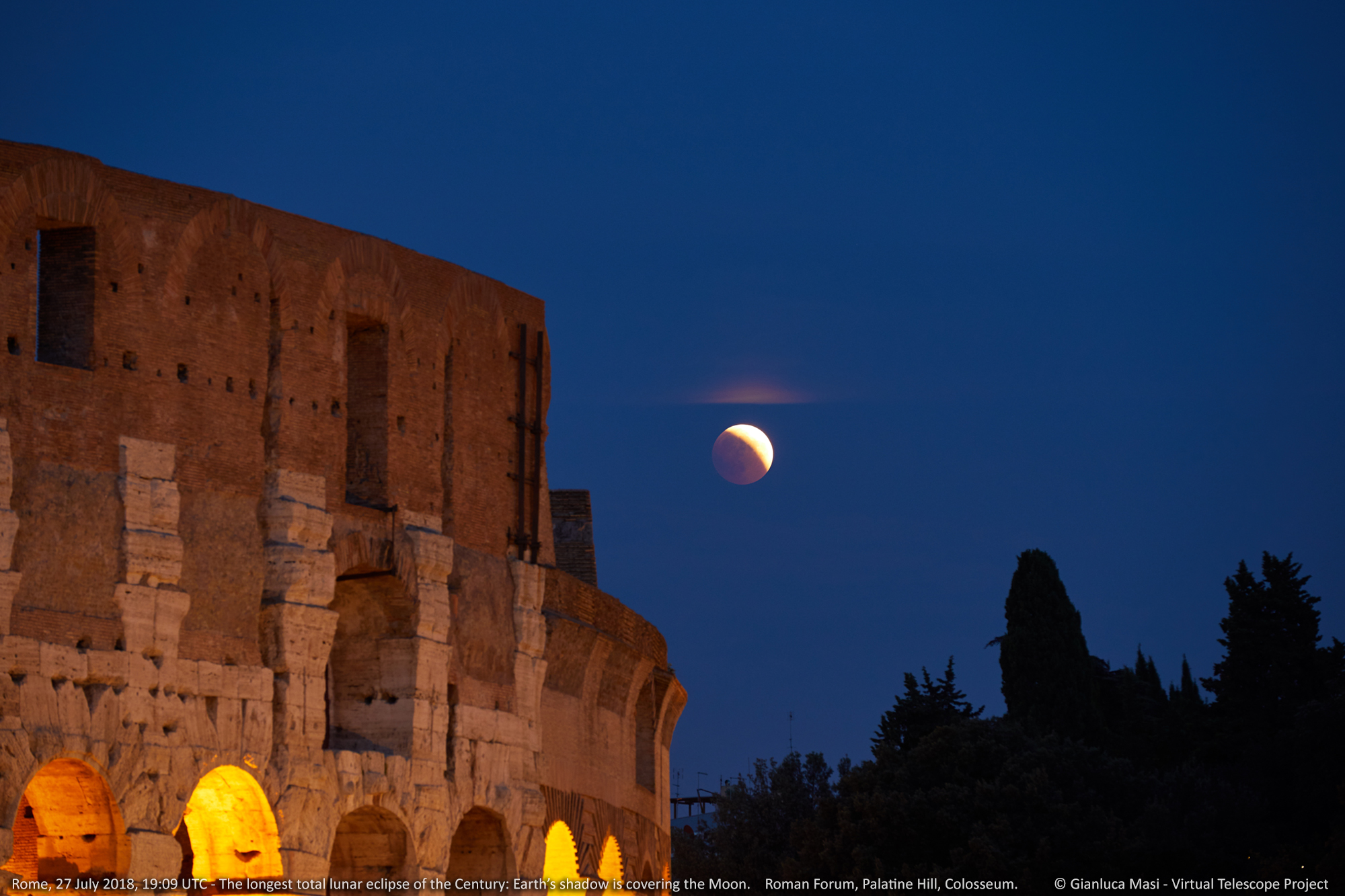 The partially eclipsed Moon opened the show, appearing beside the Colosseum.