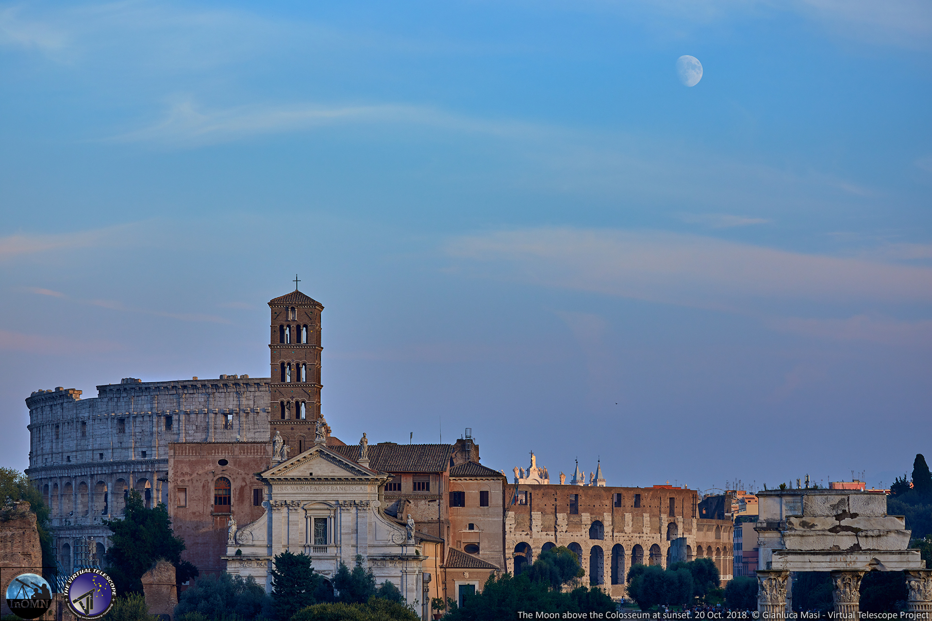 A pale Moon hangs above the Colosseum at sunset - 20 Oct. 2018