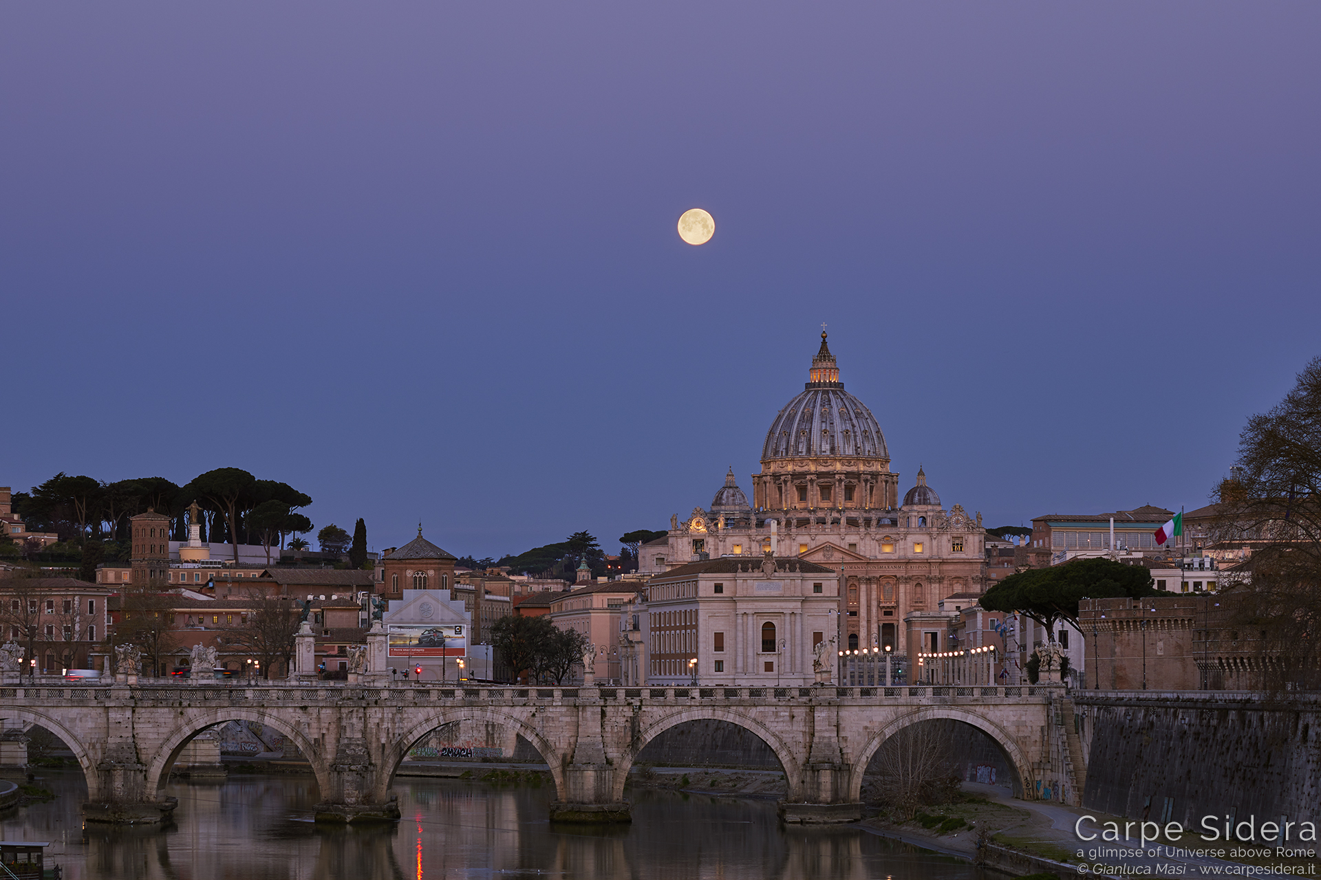 """The Supermoon hangs above St. Peter's Dome in Rome, at dawn, with a bueatiful """"Venus belt"""", the pink horizontal band on the top - 21 Mar. 2019"""