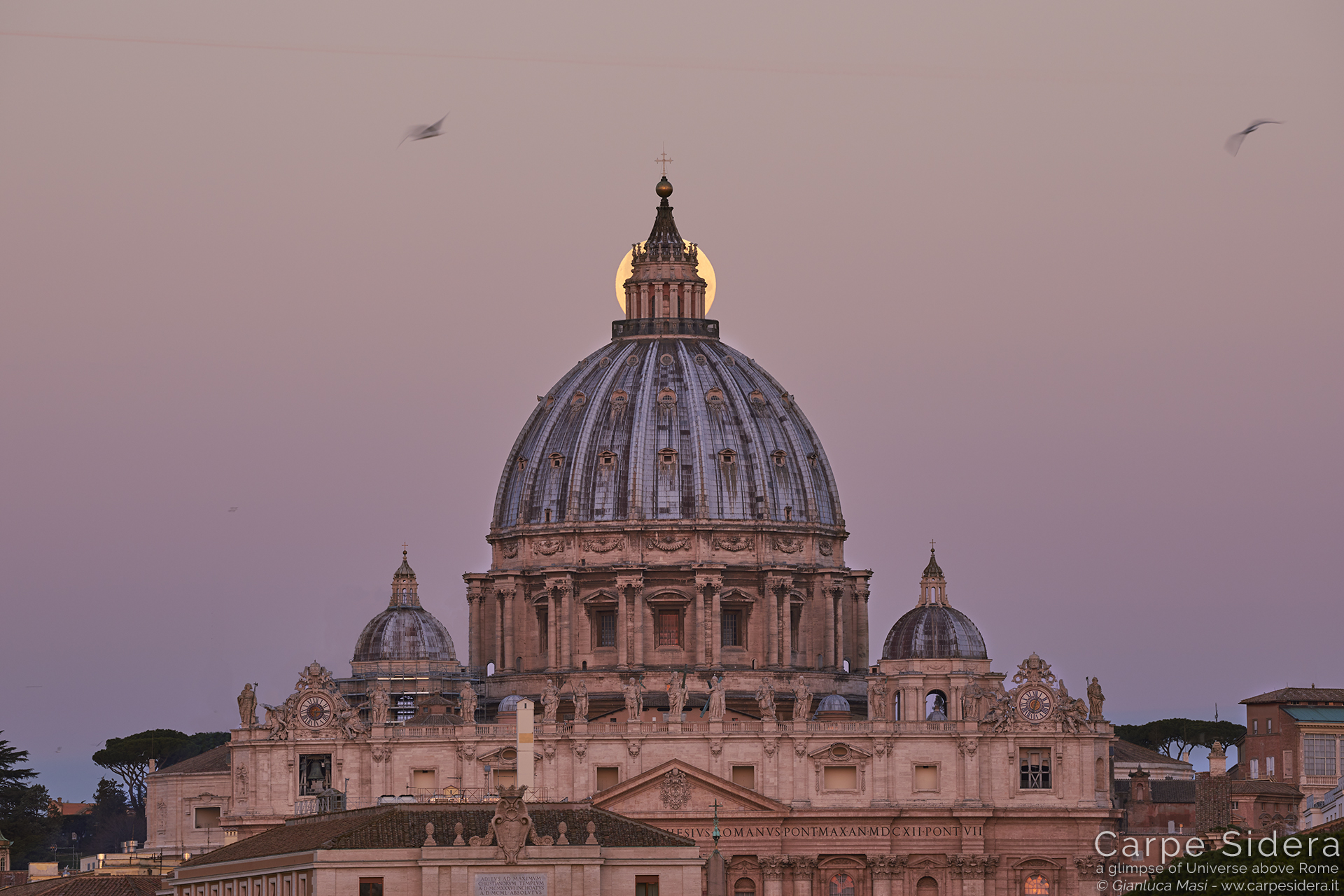 The Supermoon hides behind St. Peter's dome lantern, at last.