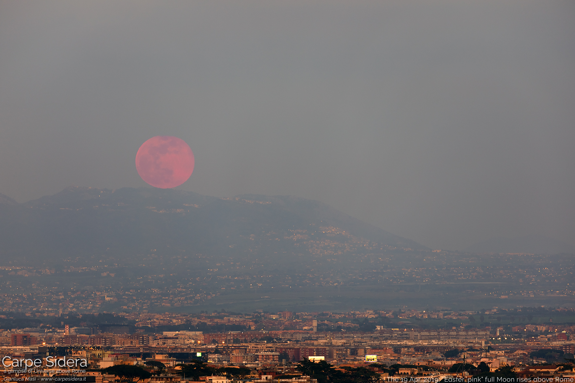 "The 19 Apr. 2019 full Moon rises soon after sunset. Its ""pink"" color is a effect of our atmosphere"