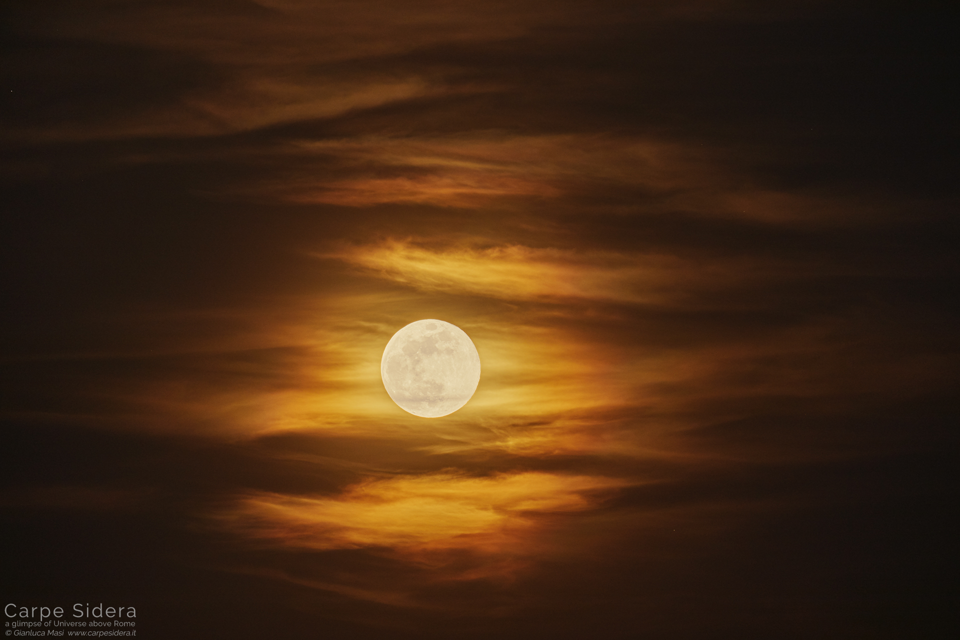 The 19 Apr. 2019 full Moon shines across the clouds.