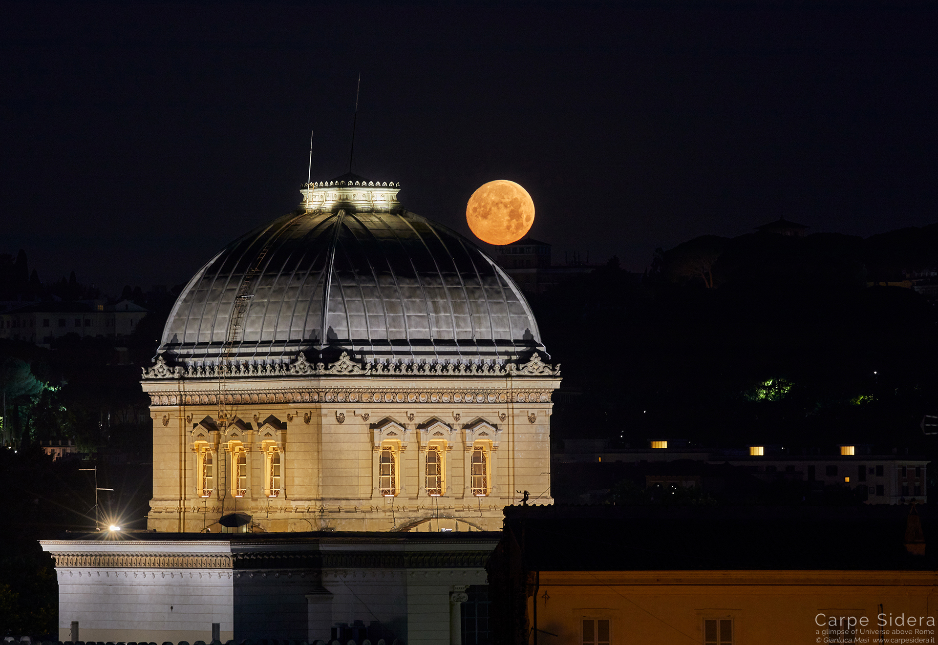 On 16 June 2019, an almost full Moon set in a still dark sky behind the Synagogue of Rome -16 June 2019