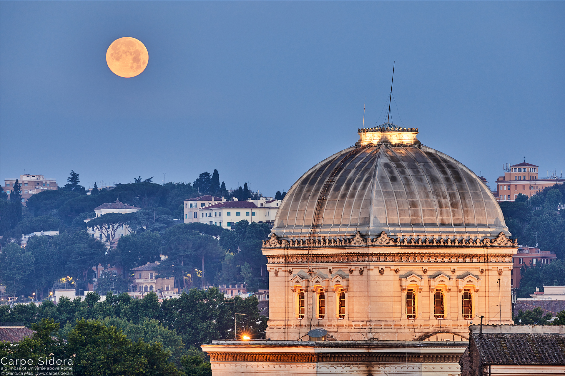 A stunning view of the Synagogue of Rome with the Moon setting at dawn - 17 June 2019