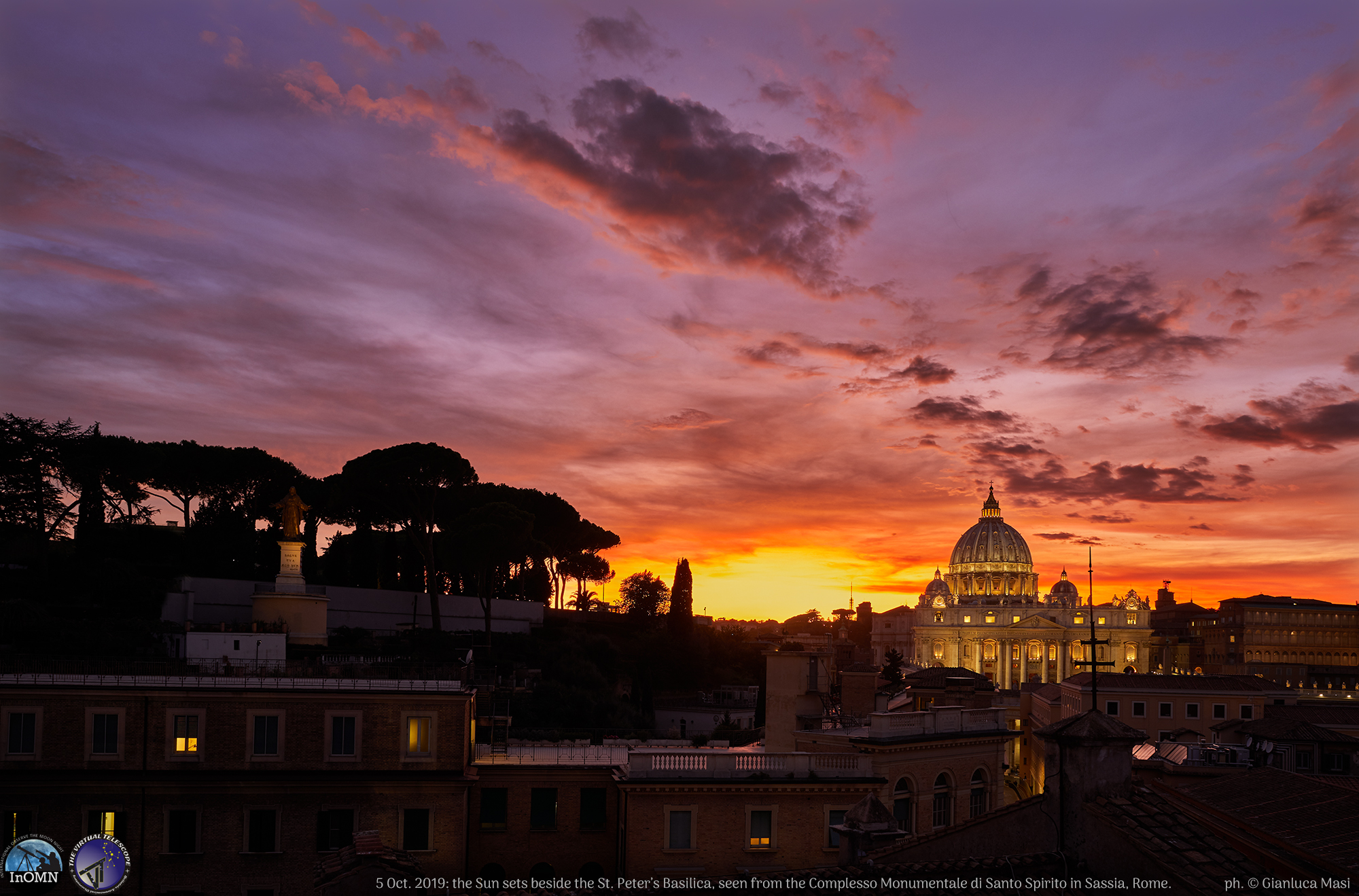"The sunset, as seen from the ""Santo Spirito""'s tower: St. Peter's Basilica dominates the western sky, with unbelievable colors all around."