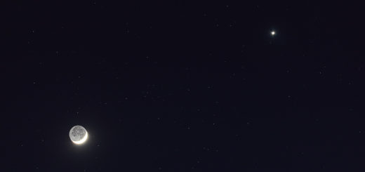 The Moon and planet Venus, against a darker, starry sky. 26 Apr. 2020