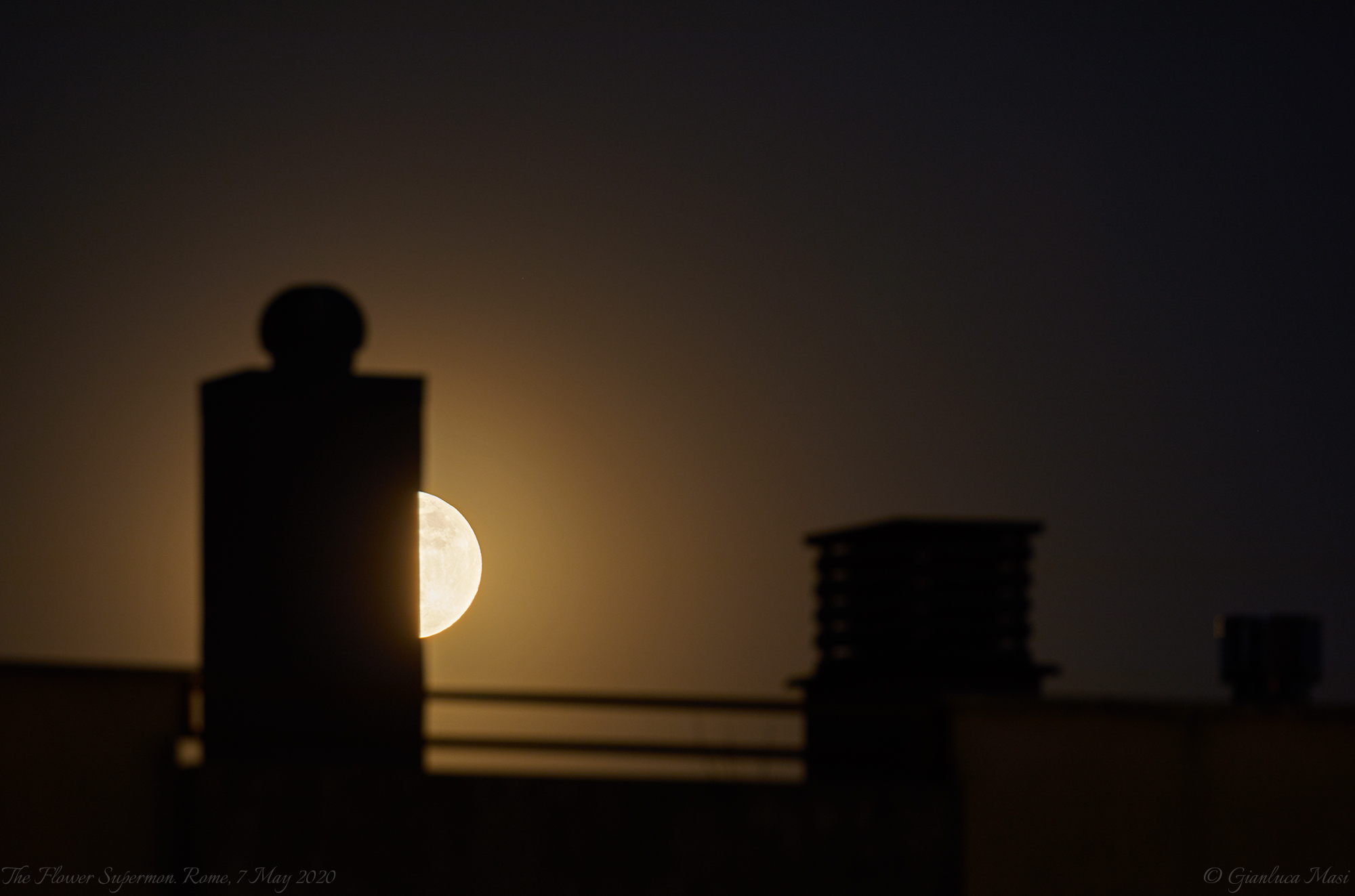 """The Flower Supermoon was playing """"hide and seek"""" among the roofs of Rome - 7 May 2020."""