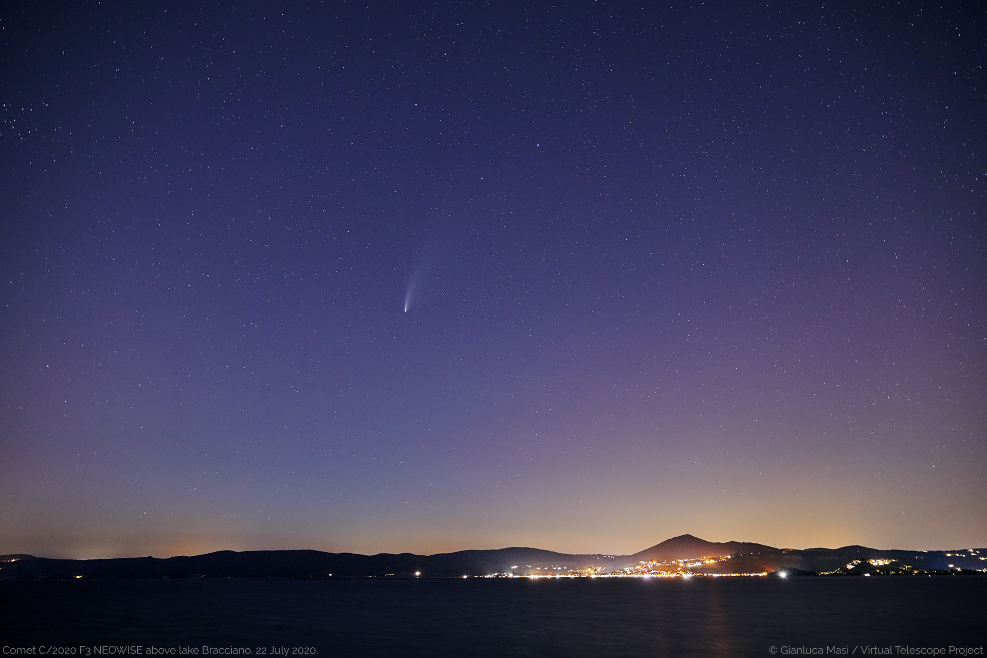 Comet C/2020 F3 NEOWISE at the beginning of the night, above the lake Bracciano, Italy - 22 July 2020.