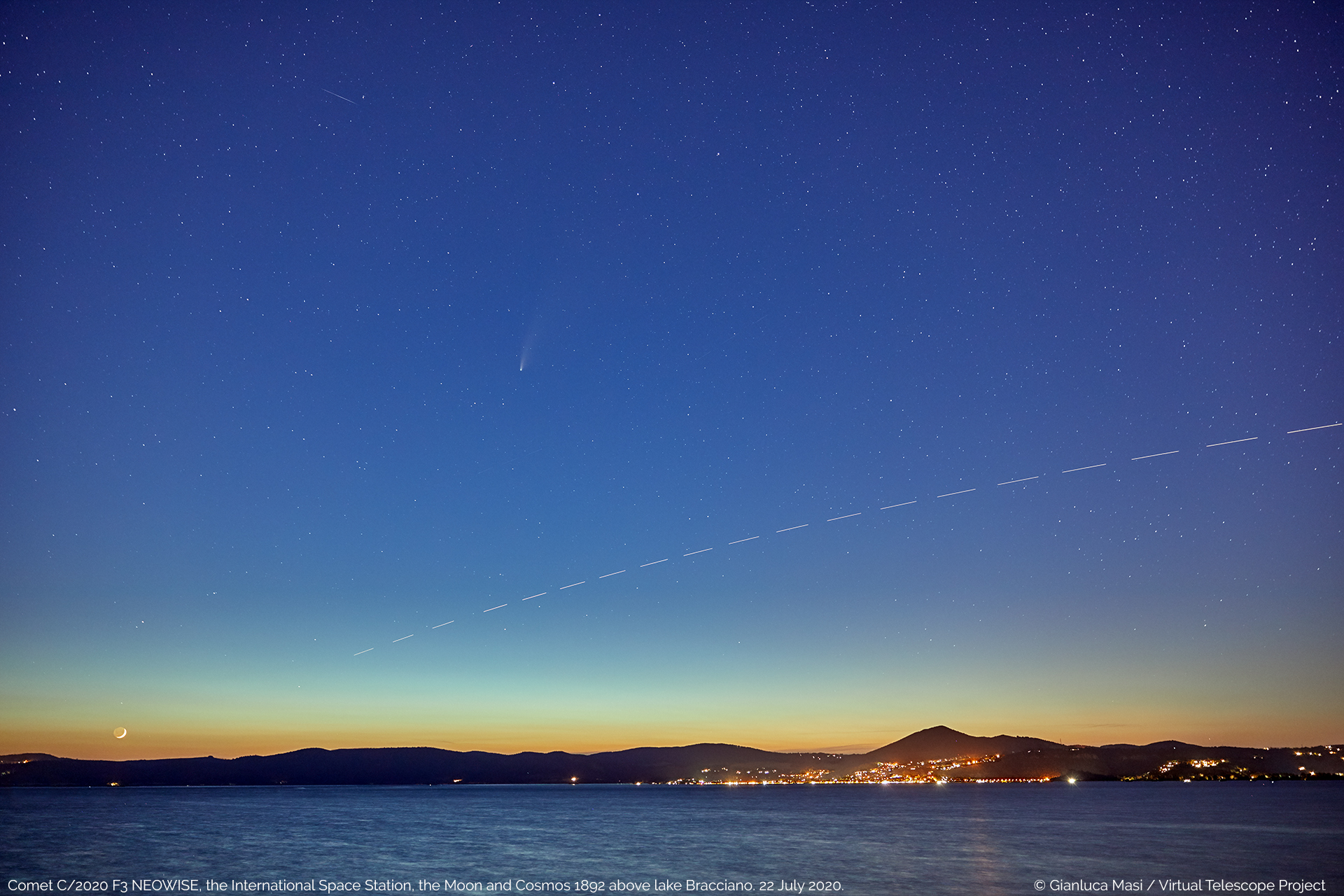 Comet C/2020 F3 NEOWISE at sunset, above the lake Bracciano, Italy, with a very young Moon and the International Space Station crossing the field of view, as well as satellite Cosmos 1892 - 22 July 2020.