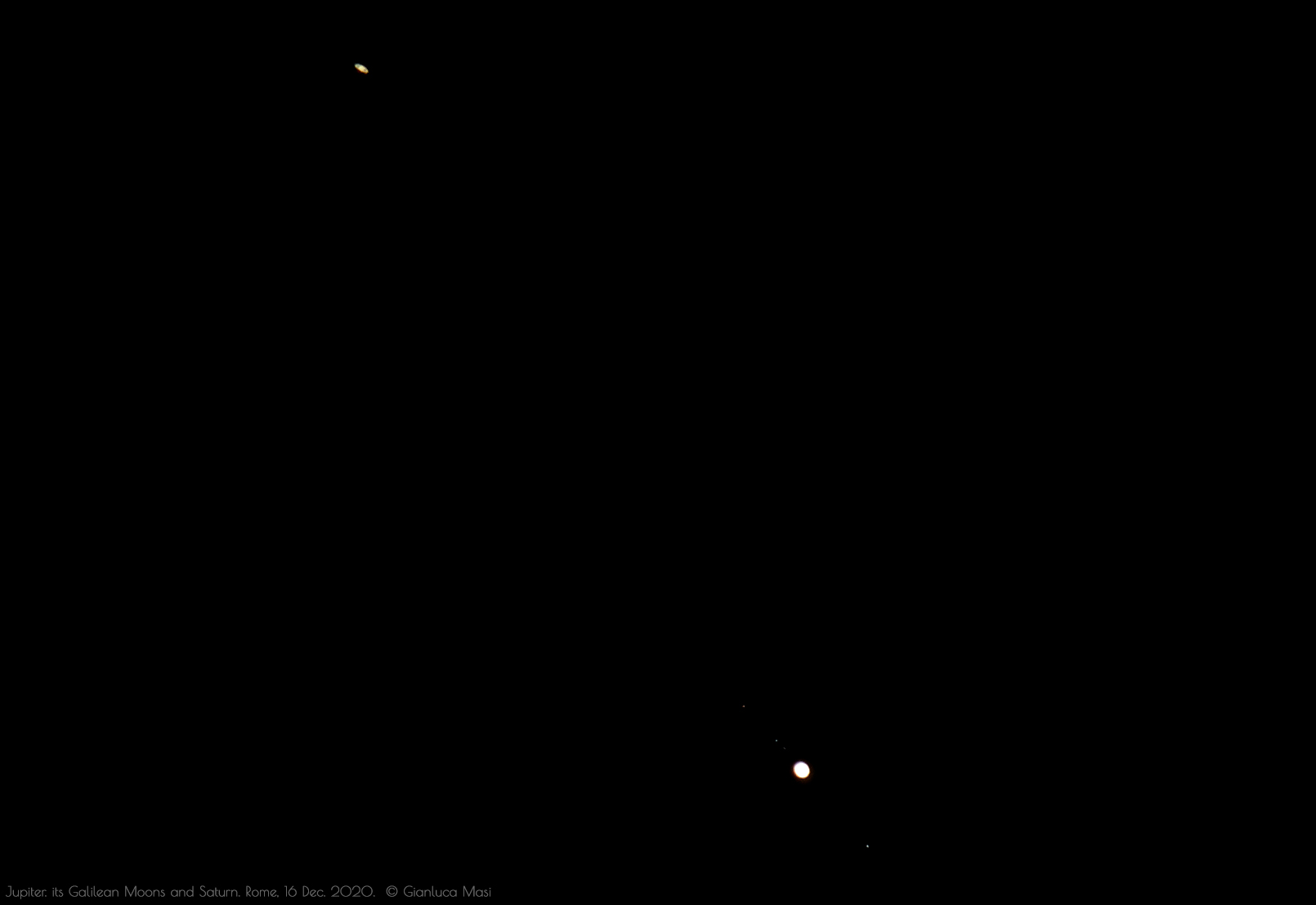 Jupiter shows its principal, four satellites in this image, while pairing with Saturn.